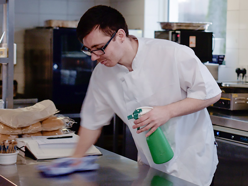 Eddie McGinley working in kitchen